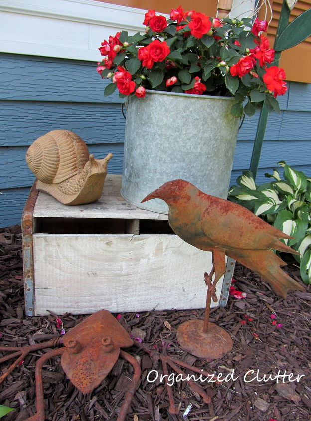 I like lots of garden decor that's rusty...