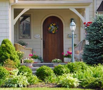 Plain, simple, yet add appeal to this small porch. The brackets, in this case, frame the entrance to the home in an arch-like fashion