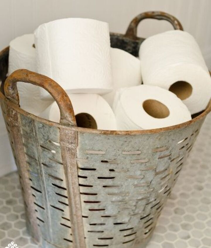 Miss Mustard Seed shares a vintage olive basket for toilet tissue display.