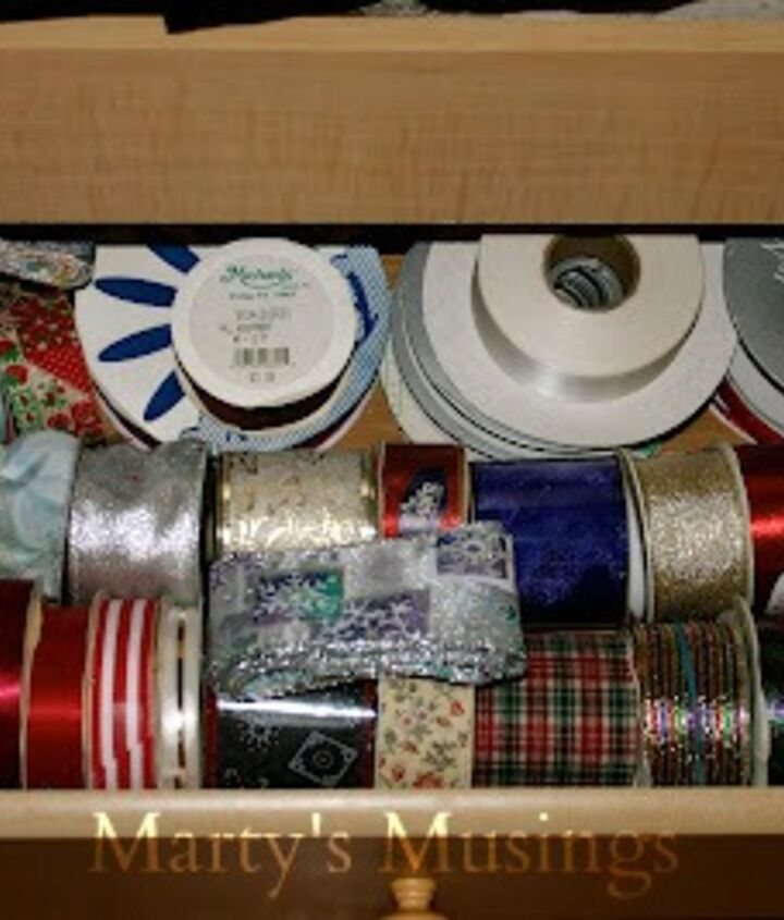 The twin bed we have in the scrapbook room has a great selling point: drawers underneath for storage. Guess what I found to put in them! More ribbon. Imagine that.