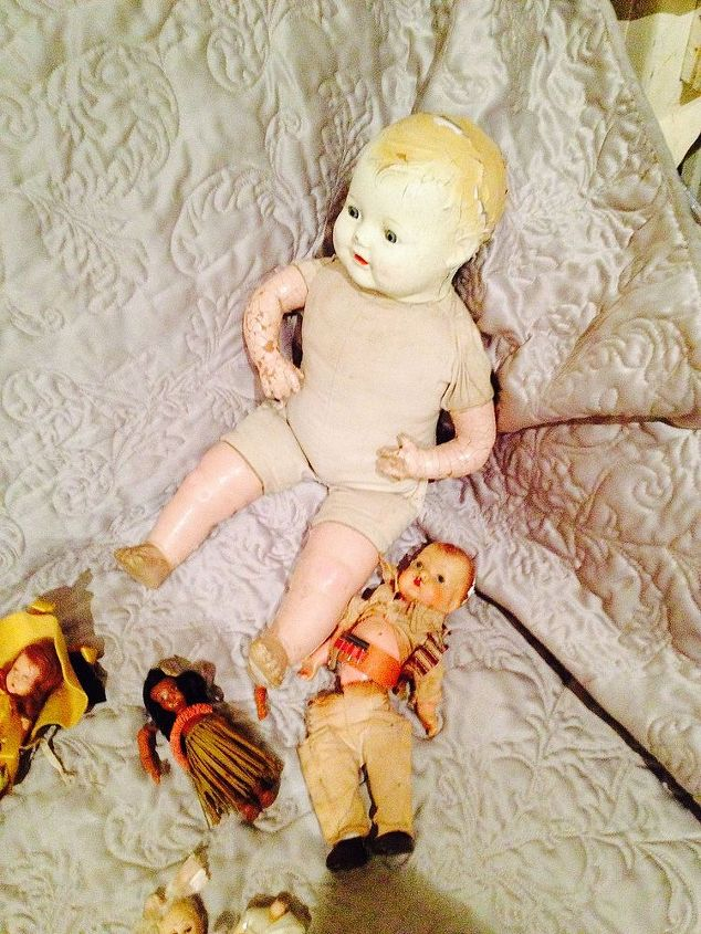 q how do you care for old dolls parts clothes, crafts, The big doll was 1 00 a few years ago She is happy to have friends