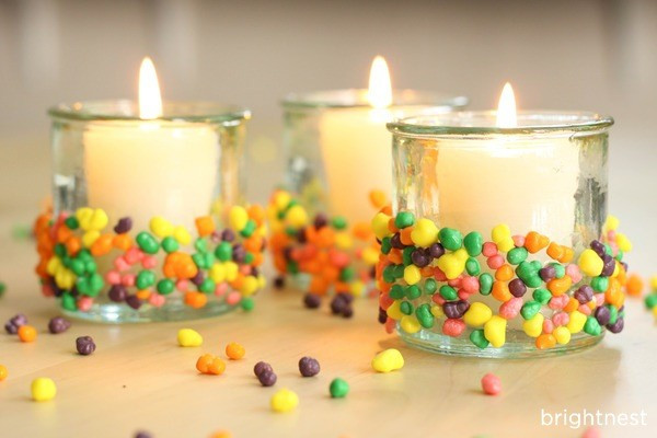 Candles. Give your holders a candy-dipped effect (this is way sweeter than the paint-dipped trend) by gluing small candies to the bottom half of the candleholder. Spray the candy with sealer to preserve its color.