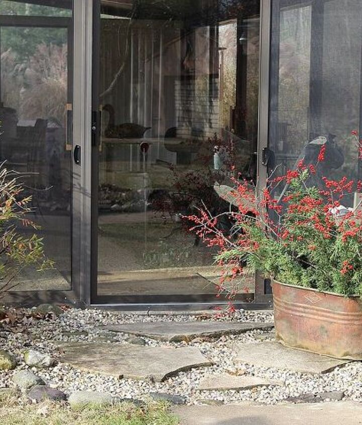 """The view at the three-season porch entry-way says """"welcome to our home!"""""""