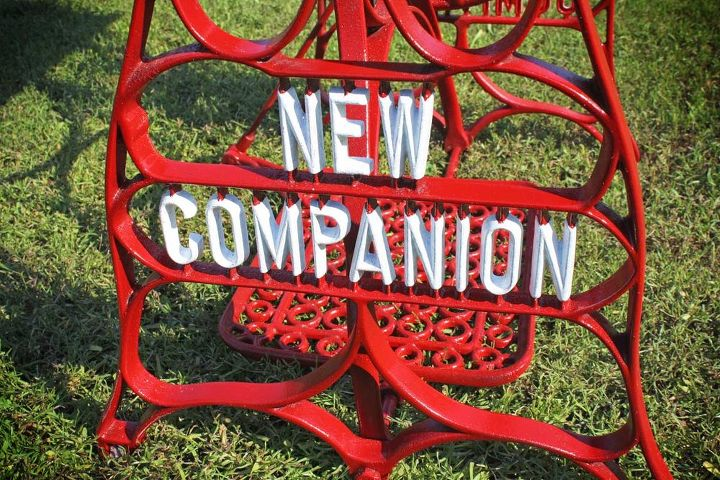 I cleaned the vintage metal base and gave it several coats of fire engine red paint.  I then hand painted the white lettering.