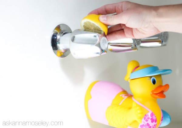 Rubbing a freshly cut lemon all over the faucets to remove the water spots.