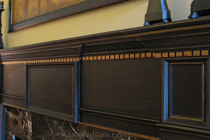 """An """"ebonized"""" faux finish on the mantel with crisp bronze highlights ties in perfectly with the painting hanging above."""