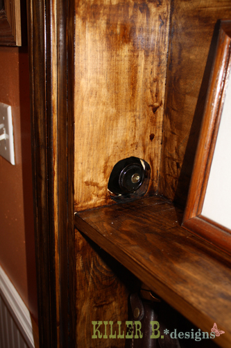 "We installed a deadbolt into the side, which fits into two 4"" screws we drilled into the wall studs."