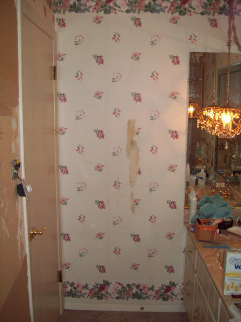 The BEFORE area behind the door.  CROSCILL wallpaper was all the rage in the 1990s.  :-)  The two mini crystal chandeliers were so amazing that I spray painted them black and converted them to pendants over my island in the kitchen.