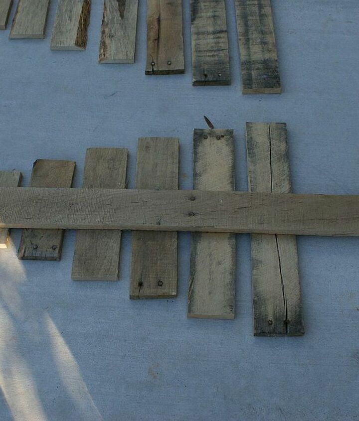 diy pallet christmas tree tutorial, christmas decorations, pallet, repurposing upcycling, seasonal holiday decor, Lay your boards out and cut another board for the trunk