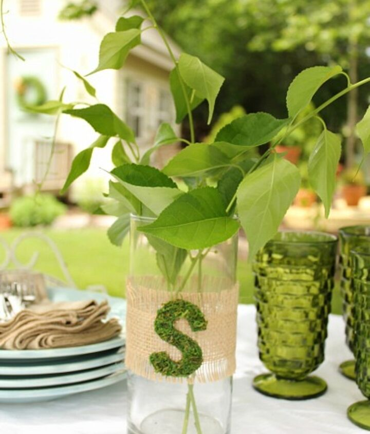 Cut an initial out of sheet moss and attach to burlap ribbon.