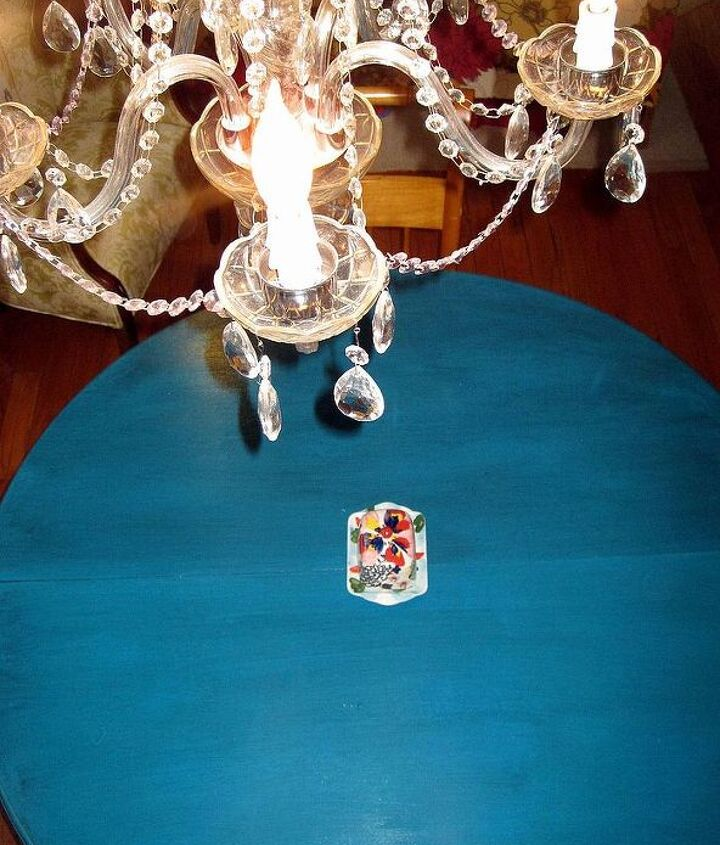 claw foot table with antique chandelier