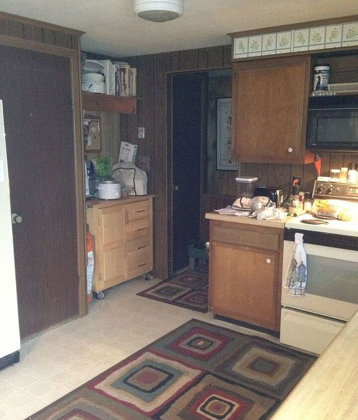 Standing in front of my sliding glass door looking towards stairway. Microwave cart area I am thinking about expanding my pantry to this area