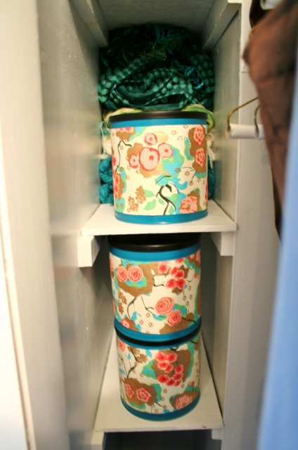 Upcycle coffee tins with spray paint and paper for a beautiful storage container.