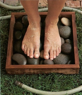 Find or make a tray pallet easy to stand in and with plenty of room for your feet. Add River Stones , add a little water , just enough to cover the bottom...keep outdoors in the sun. A nice heated mini foot massage!  Good for the sole!