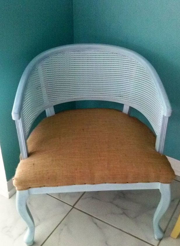 A beachy burlap seat!  I was going to use a rope trim to cover the tacks, and then decided I kind of liked the look.