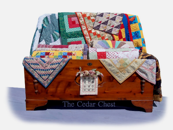 The Cedar Chest holds my Quilts...from Miniatures to an Amish Dresden Plate, which I had received as a gift quite a few years back..