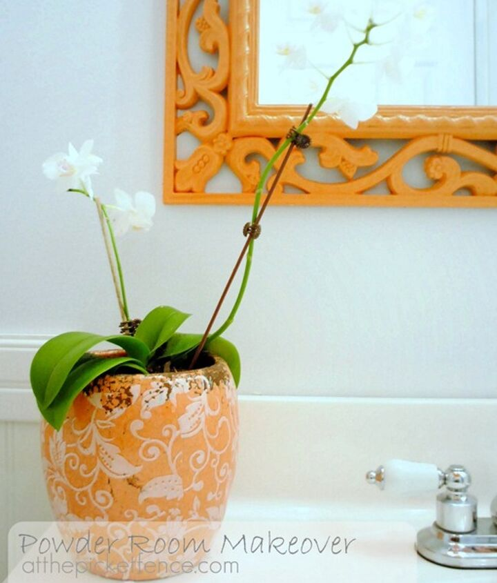Tangerine mirror anyone? I painted over an old mirror with this fresh color for a whole new look.
