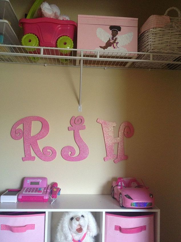 Her initials hang between her top shelf and organizing system