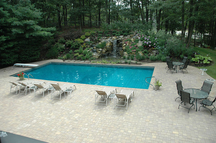 New Cambridge patio that replaces old concrete patio around the swimming pool. Project by Deck and Patio Company Huntington Station New York. Read more- http://www.deckandpatio.com/DP_Blog/?p=1013