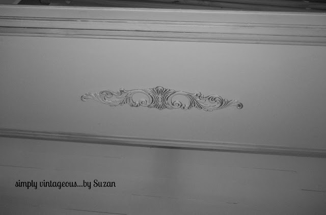 The baseboard also had a piece of MDF inserted into it  Painted white with an applique glued on