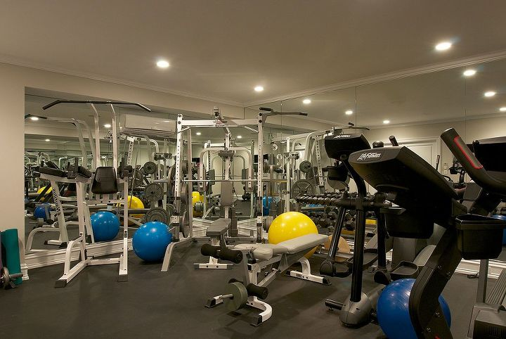 Gym in basement Renovation by Titus Built, LLC.
