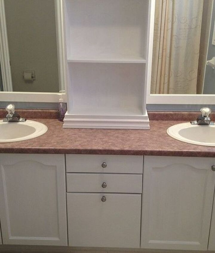 large bathroom mirror redo to double framed mirrors and cabinet, bathroom ideas, home decor, shelving ideas, we also spray painted the knobs a brushed nickel