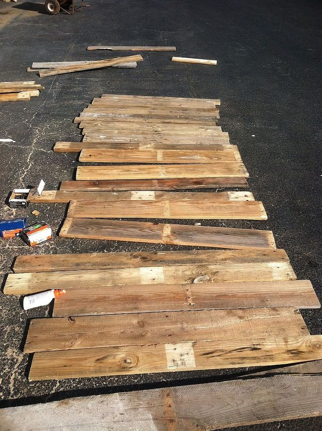 turned thrown away pallets into awesome laundry room shelving unit, diy, laundry rooms, pallet, shelving ideas, This was the wood we used to build shelving unit We broke it apart from old weathered pallets