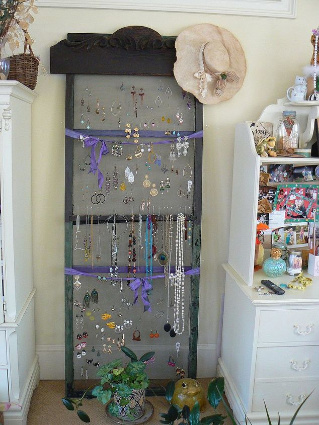 Hang earrings and necklaces on an old screen door.