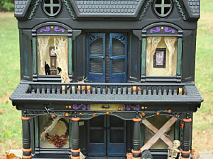 easy halloween decoration to make, crafts, halloween decorations, seasonal holiday decor, I saw this idea in an old issue of Country Living I thought it was so clever You just spray paint an old doll house black and turn it into a haunted house