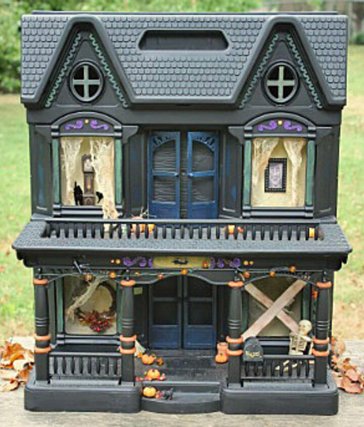 I saw this idea in an old issue of Country Living.  I thought it was so clever!  You just spray paint an old doll house black, and turn it into a haunted house!