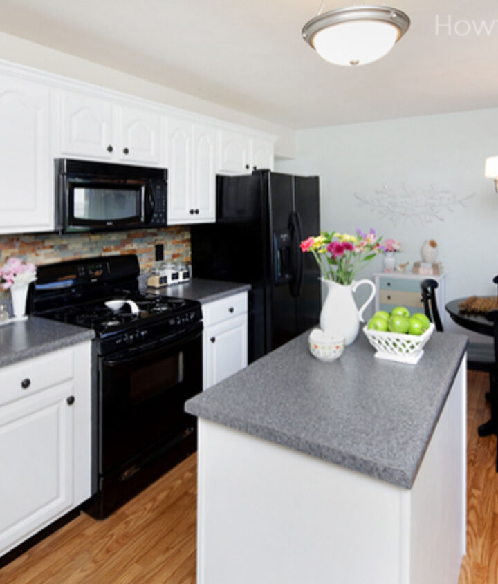 Painted kitchen cabinets using Sherwin Williams Pure White