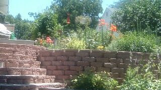 q cheapest way to make a large retaining wall, concrete masonry, landscape, outdoor living, The steps were a little tougher to iplement