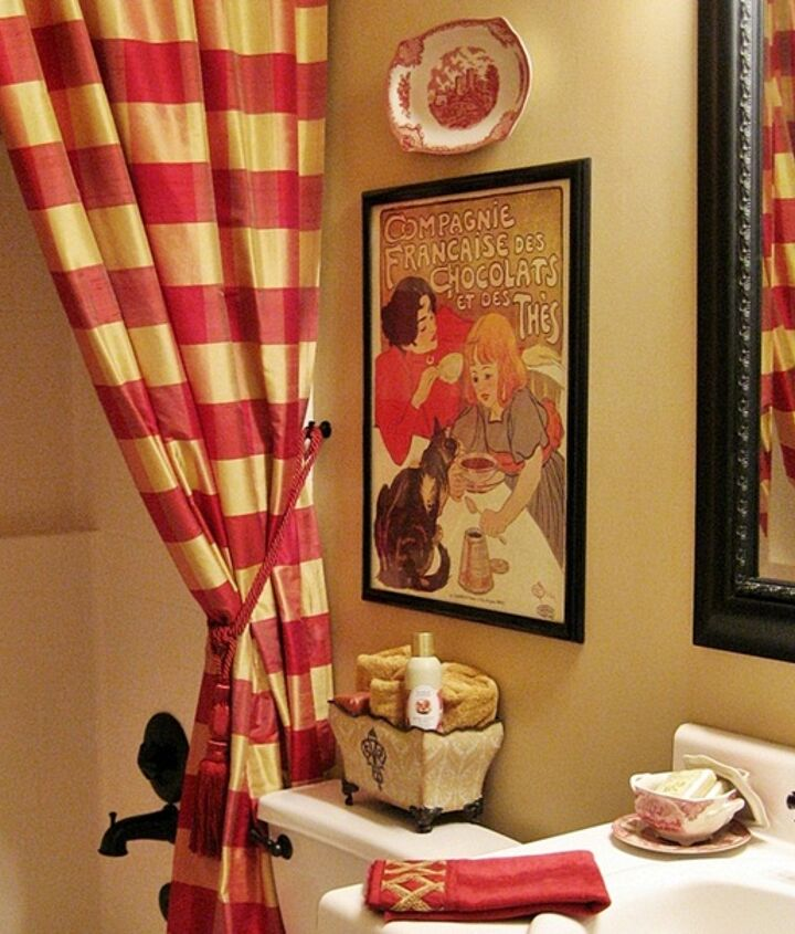 To add French country style to my bathroom, I used a pair of floor to ceiling buffalo check drapery panels as the shower curtain...with a liner behind them, of course. A frenchy print and a transferware plate add to the look.