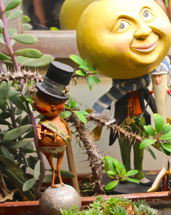 Mr. M-I-T-M with the New Year Baby (as well as Mizz Champagne) in my succulent garden.
