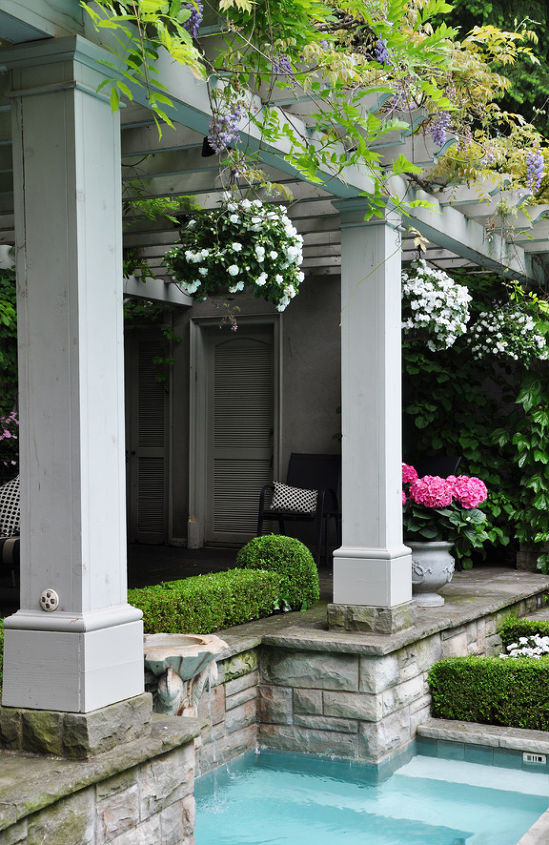 Hanging baskets of flowers and potted plants are used for summer-long color.