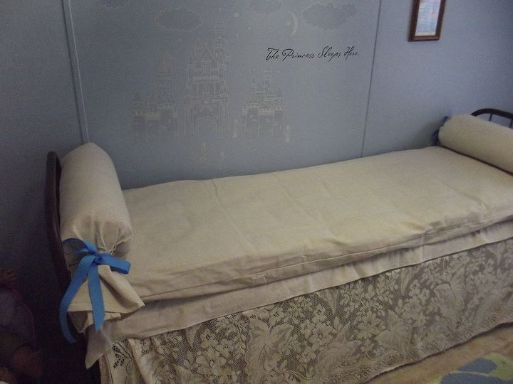 Bedskirt is an antique table cloth and bolsters are pillows I rolled, duct taped and covered in drop cloth canvas.