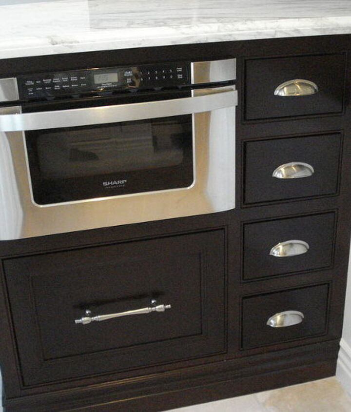 Microwave in a base cabinet! The island has a tall Mahogany eating bar section.