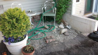 q 100 quick patio fix, outdoor living, patio, this shows the gravel that covered the area that is now deck