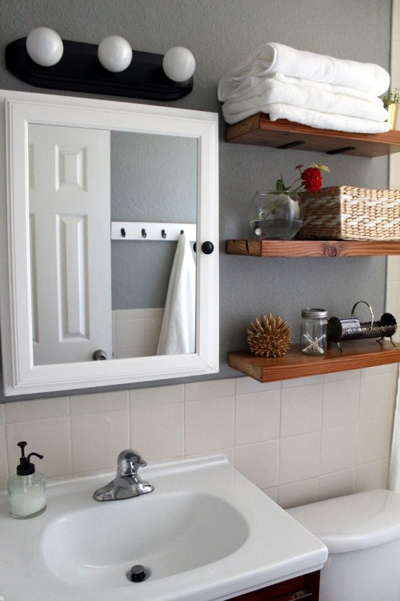 70 bathroom makeover, bathroom ideas, home decor, repurposing upcycling, shelving ideas, small bathroom ideas, Save money by updating existing fixtures with spray paint I spray painted the light fixture cabinet knob and soap pump with less than one can of spray paint