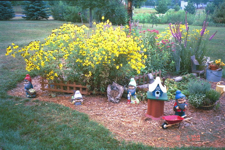 Another shot of the front garden using various items from my antiques, collectibles and salvage collection.