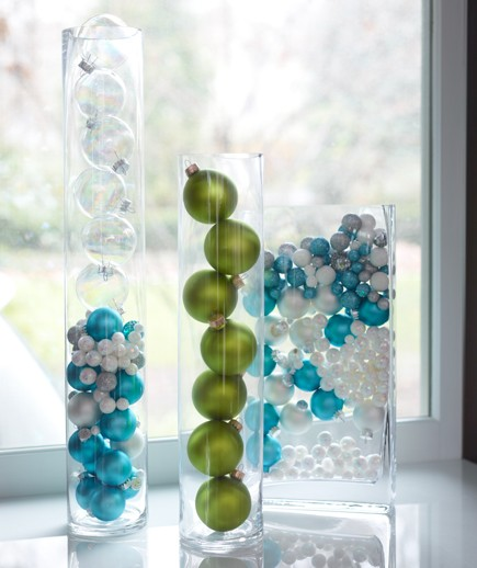 Take unique vases or any glass containers and fill with ornaments or holiday candy for instant color!