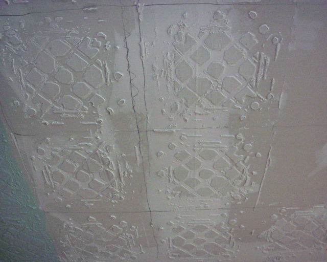 Remove the stencil.  Repeat across your ceiling until all the tiles are there.