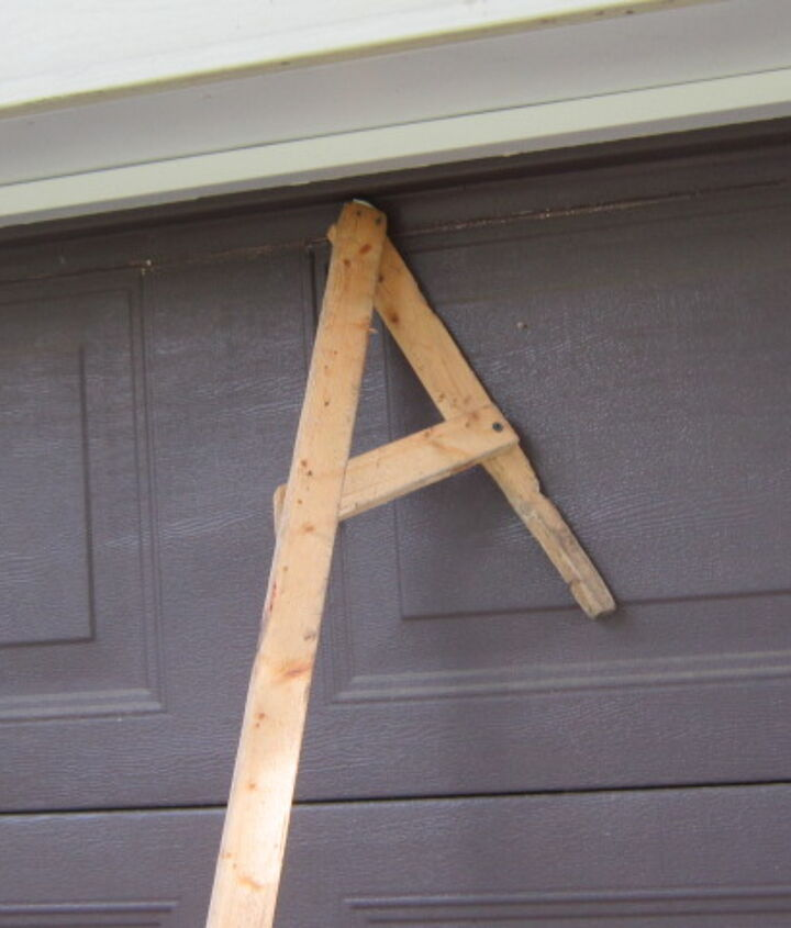 My homemade gutter cleaner is a 1x2x10 piece of lumber with a V-type end  and a cross-brace.