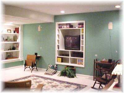 Basement before, when we moved in with built in entertainment center and horrid color walls.