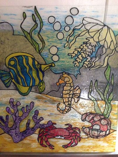 $3.00 thrift store find turned into Faux stain glass art. Under the Sea