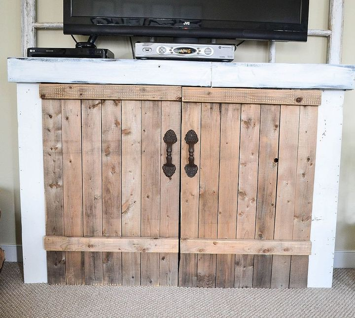 I made this cabinet with scraps from a fence and an old bed frame and the previous wood from the mantel.