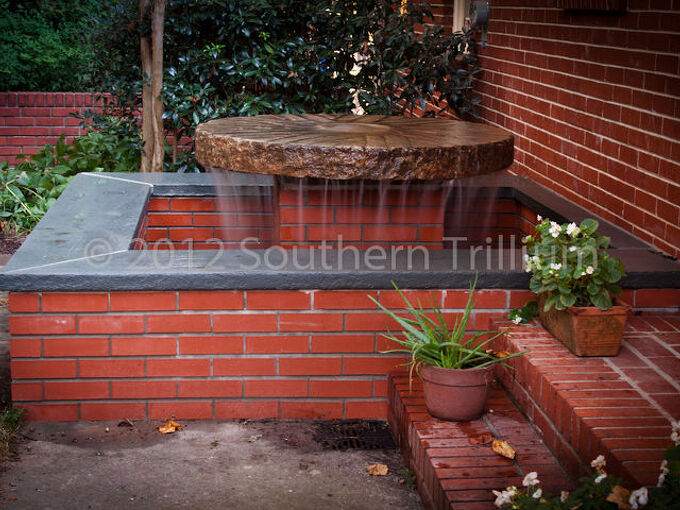 we worked with a client to showcase a 48 granite millstone in the small garden, gardening, ponds water features, A custom fountain showcasing a 48 antique granite millstone The millstone weighs around 800 pounds The functioning water level height is normally one brick below the bluestone top