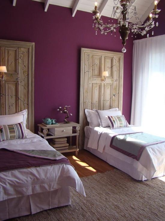 A fairy-tale headboard design with doors used as headboards. By Architecturedesigns.com