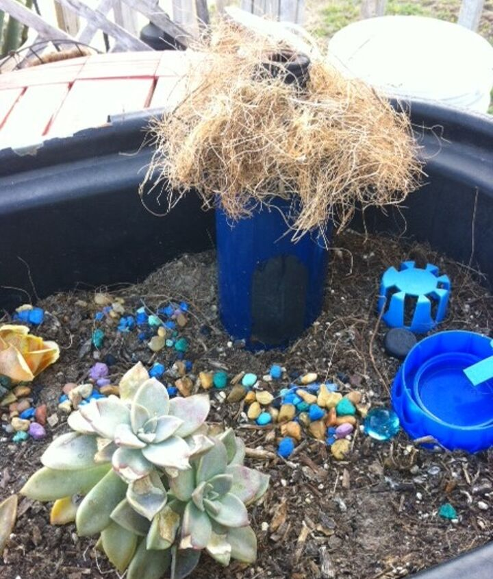This is a Fairy Garden in the making..Much to do! Notice the swimming pool to the left, lol