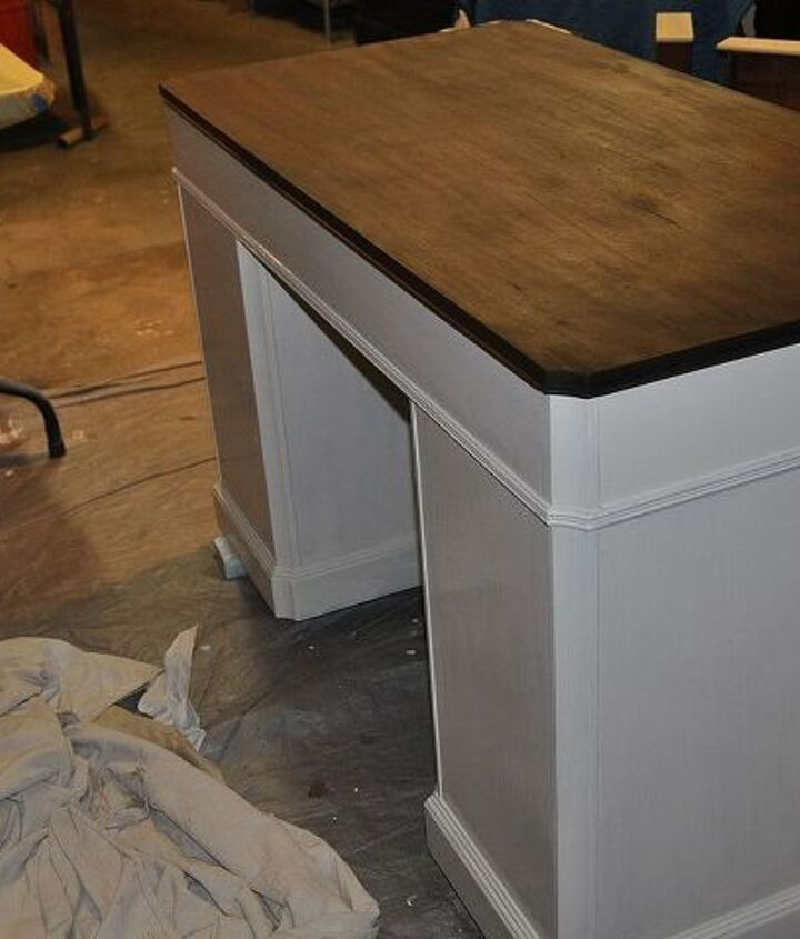It took more than one coat of stain to get the dark color, the red mahogany wood wanted to peep through a little too much.
